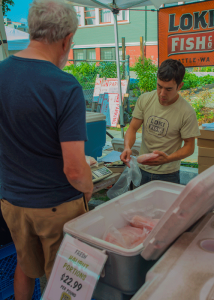 Keeping the fish moving at the farmers market.